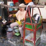 The Tongseng (Javanese spicy goat meat soup) seller in their typical cart in Glodok area, Jakarta. Tongseng is a speciality of Solo (Surakarta) city, Central Java.